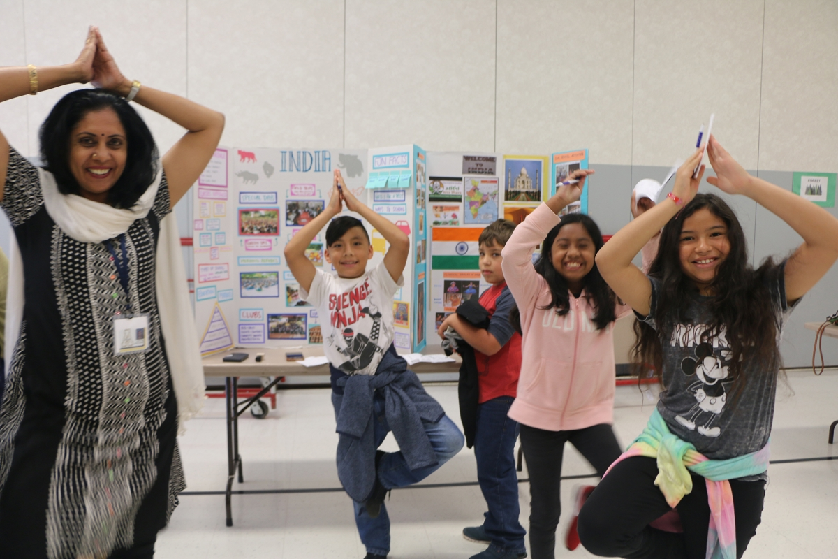 Students learning yoga