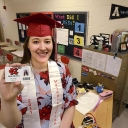 ROBERT C. REED/HICKORY DAILY RECORD: Ashley Bandy, 2011 valedictorian at Newton Conover High School, is now a mathematics teacher at her hometown high school as she holds her teacher identification card.