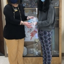 Betsy Rosenbalm presents mini grant to recipient.