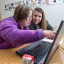 Graduate assistant Miriam Stapp, right, and Victoria Hall work on her writing assignment together.