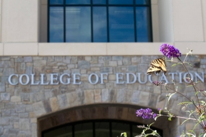 college of education building with butterfly on flower