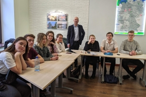 Dr. Paul Wallace, professor of instructional technology at Appalachian State University and a 2019–20 Fulbright scholar, standing, is pictured with his class at Yaroslav-the-Wise Novgorod State University in Veliky Novgorod, Russia.