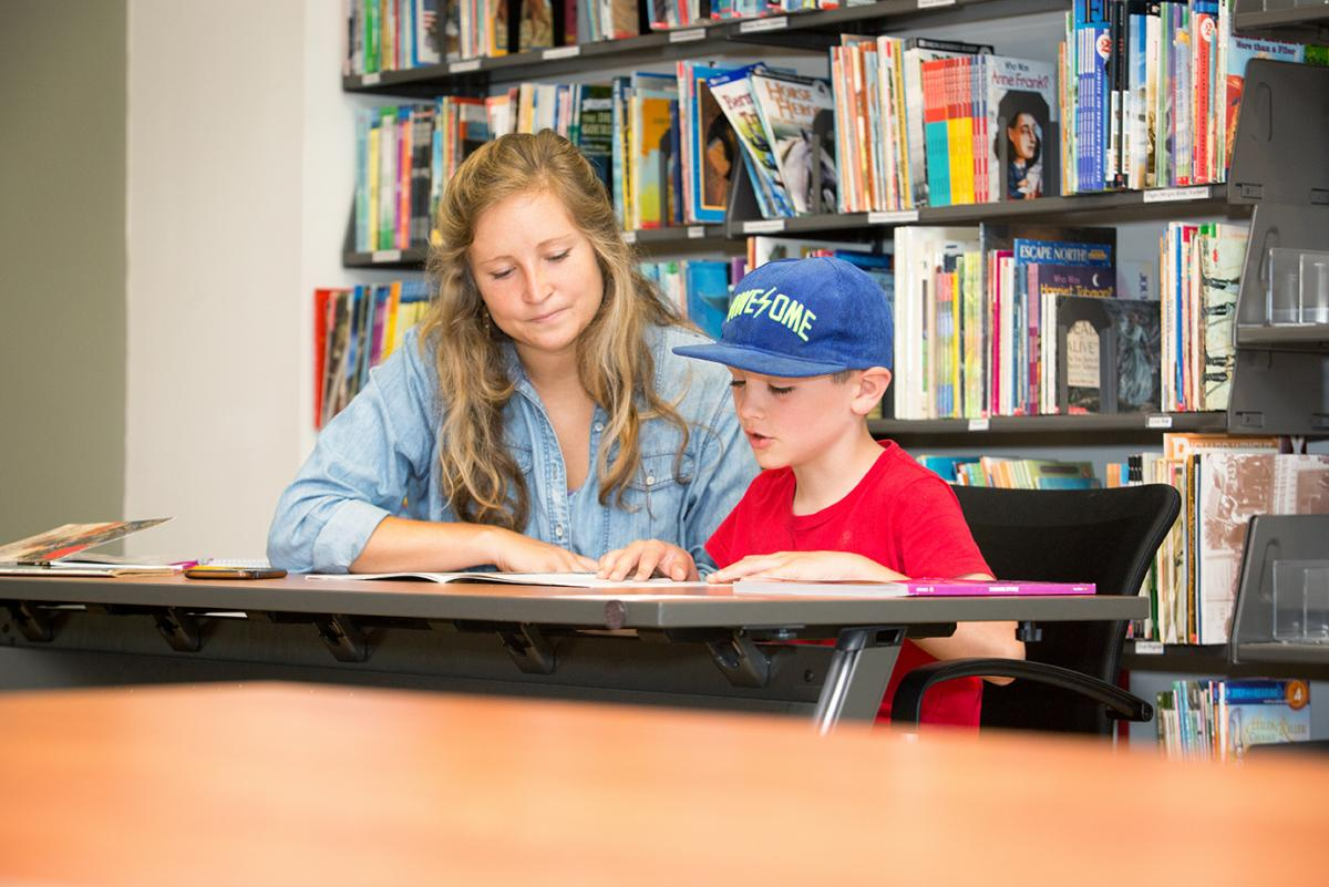 The Anderson Reading Clinic, which serves 100+ annually, provides direct service to children with reading problems. Each child receives approximately 15 hours of one-to-one reading and writing instruction. Photo by Marie Freeman