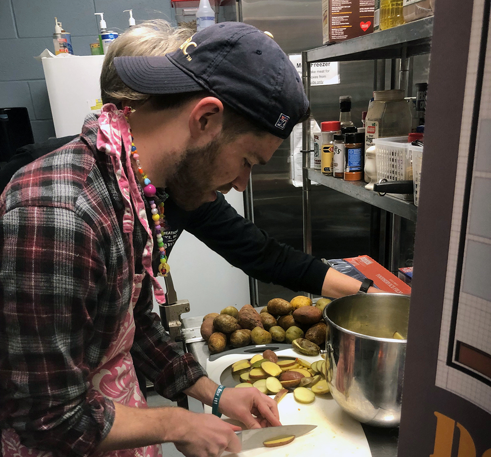 Alex Olinger hand cuts russet potatoes and sweet potatoes to home-baked french fries. Photo submitted