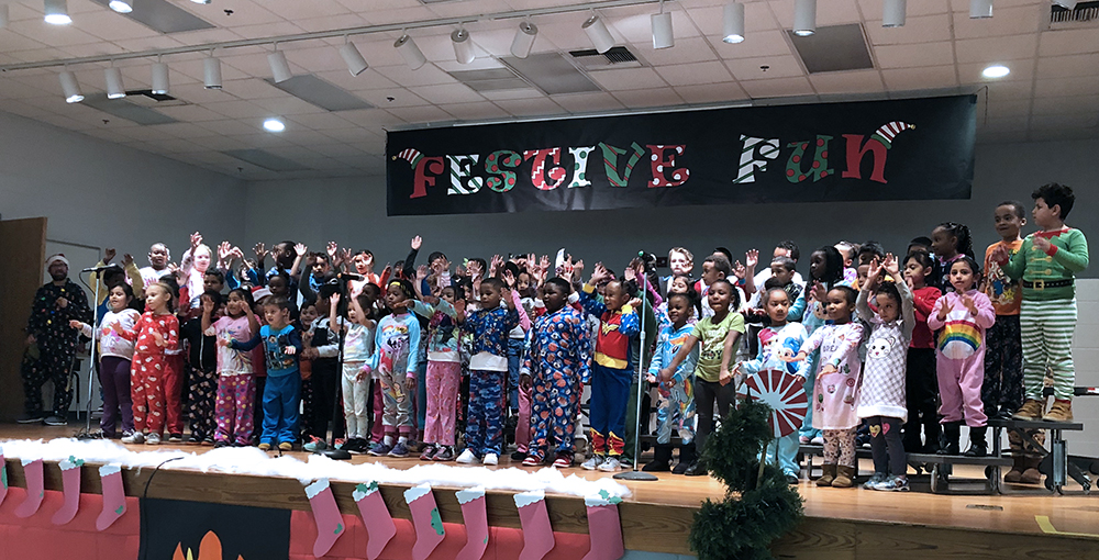 The Academy's kindergarten and 1st-grade students dance and sing during the first Fun Festive Program.