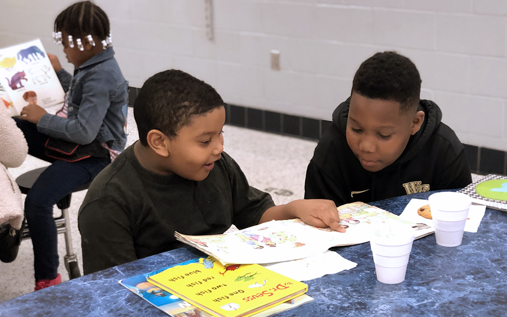Adrian Haney (4th grade) and Jhoan Mendez-Candela (1st grade) read together during Books and Buddies.
