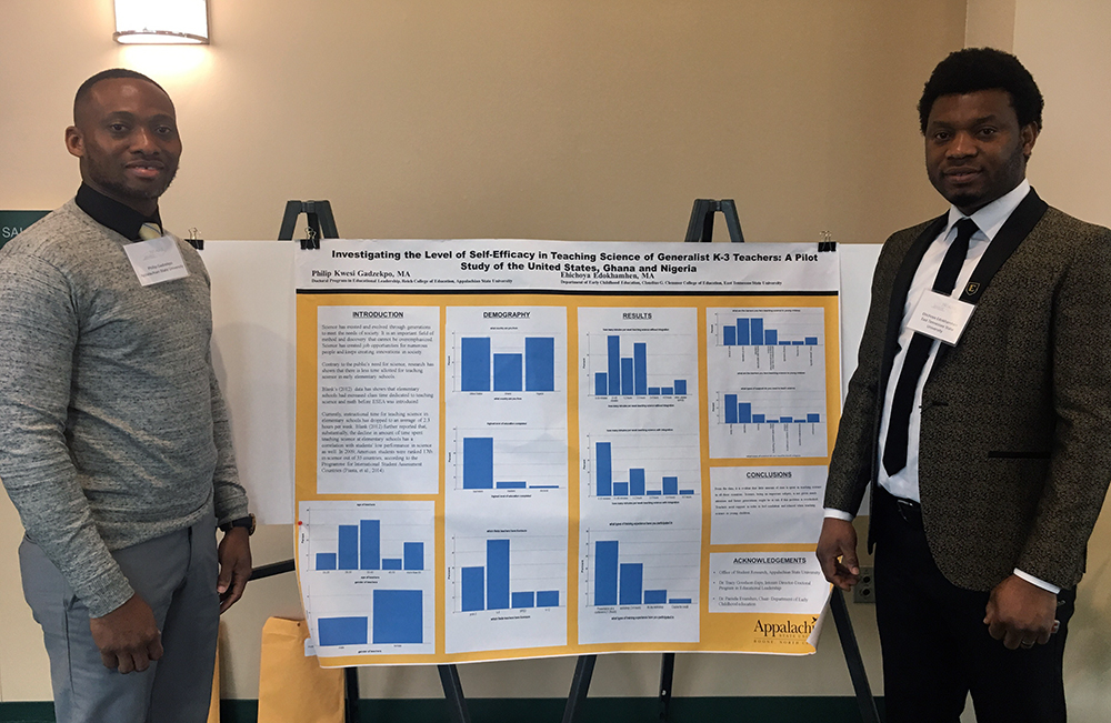 "Doctoral candidate, Phil Gadzekpo (left), presents his poster titled ""Investigating the Level of Self-Efficacy in Teaching Science of Generalist K-3 Teachers: A Comparative Study of the United States, Ghana and Nigeria"" along with co-presenter, Ehichoya Edokhamhen (right)"