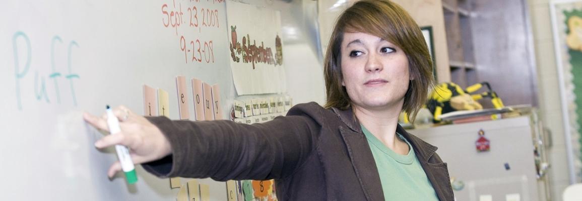 student teacher at whiteboard