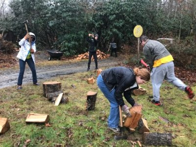 Talk about hands-on learning! AMS students teaching ASU visitors how to chop wood on a dreary Saturday.
