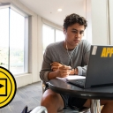 Zach Covington, a first-year exercise science major at Appalachian, looks at his laptop while taking notes