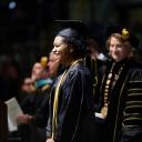 Graduating senior Maya Brown-Hughston approaches the podium as Appalachian State University Chancellor Sheri Everts looks on. Photo by Chase Reynolds