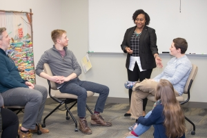 Dominique Hammonds talking with students