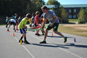 Boys participate in a challenge during the Xcel2Fitness after-school program designed by Stephen Vaughn '05, who
