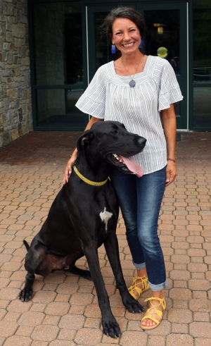 Karla with her dog, Sydney. Sydney is a registered therapy dog.