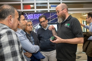 Data and Assessment Specialist Jim Dees in Appalachian State University's Office of Sustainability, right, shows visitors from Kurdistan, Iraq, a mobile app during a campus tour of Appalachian's sustainability initiatives.