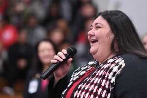 Meghan LeFevers, sole 2017-18 Milken Educator Award recipient from North Carolina, addresses an assembly of students, staff and guests gathered in her honor within Bessemer City High School's gymnasium. Photo courtesy of Milken Educator Awards