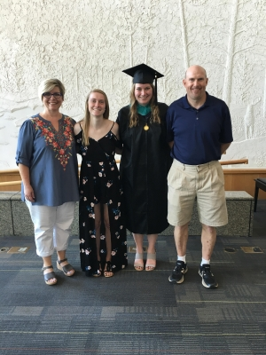 Marie (far left) with her family at her daughter's MPA hooding ceremony.