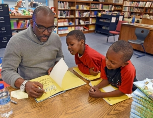 Derrick Barnes signs books